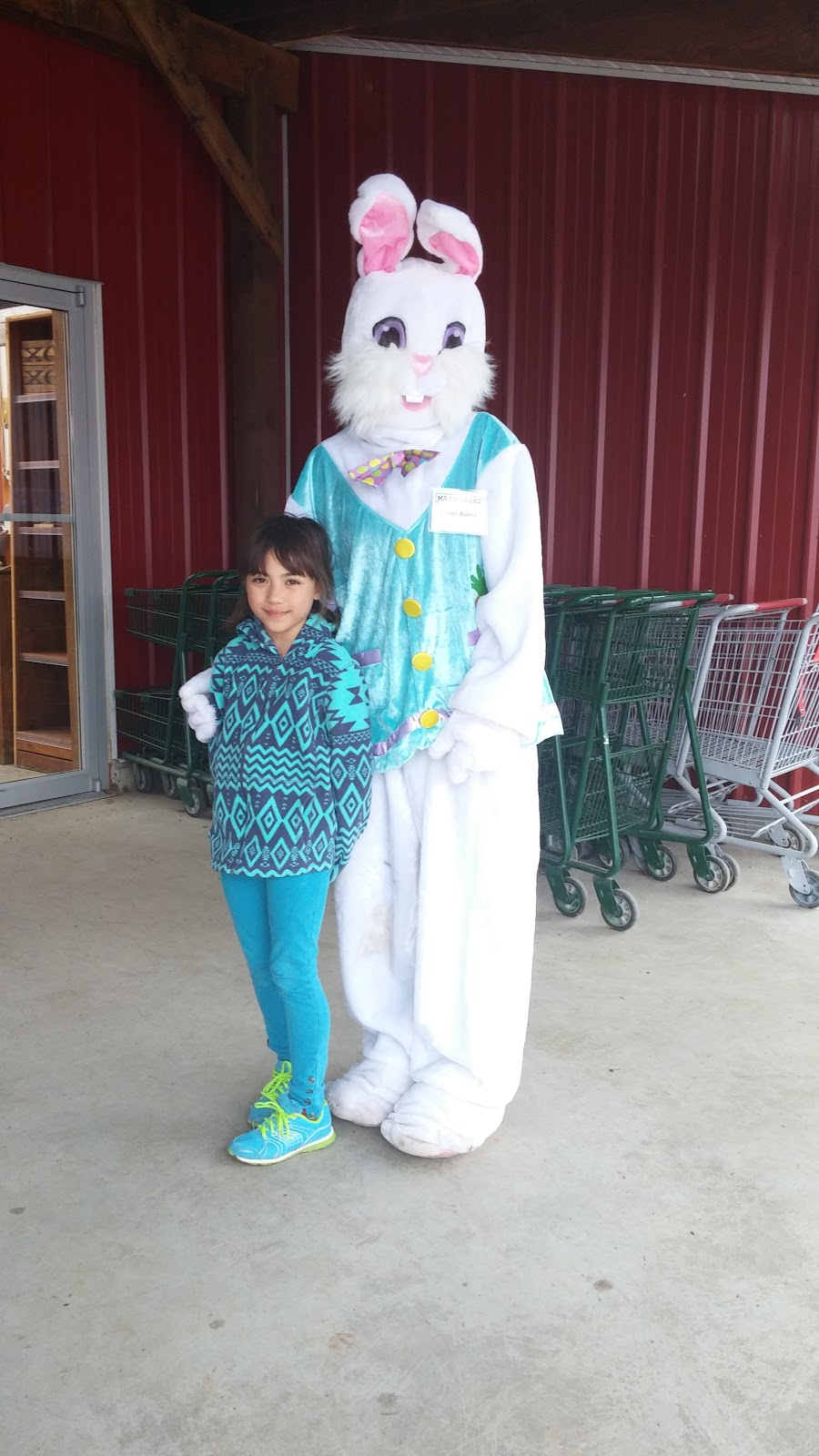 My eldest daughter picture with the Easter bunny lady!Maan farm is really great, though I paid the entrance fee for my two girls about $18 something I believe but it sure my kids had so much fun! My son were free because he was under 3  year old. The small zoo they have on the farm is awesome!