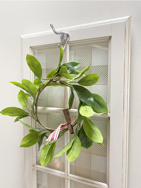 wreath hanging on window