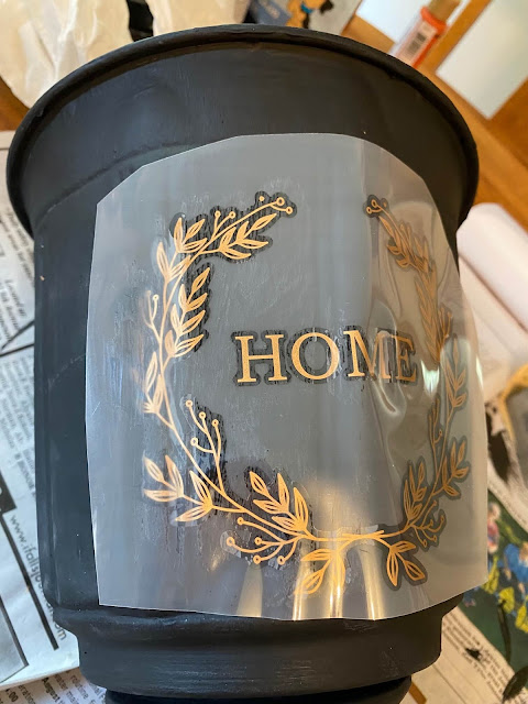 Photo of a partially applied decor transfer to an urn
