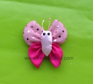 Aksesoris kupu-kupu yang dibuat dari bahan kain perca