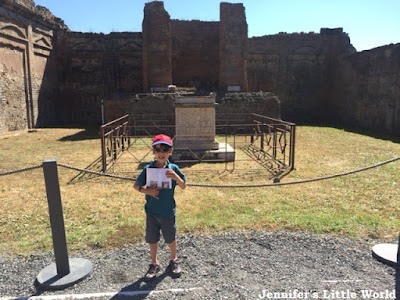Child standing in front of building in Pompeii