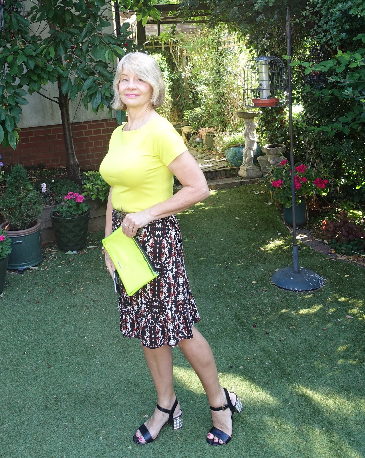 Is This Mutton blogger Gail Hanlon in knee length flippy skirt from TU at Sainsburys and acid yellow tee from  Kettlewell
