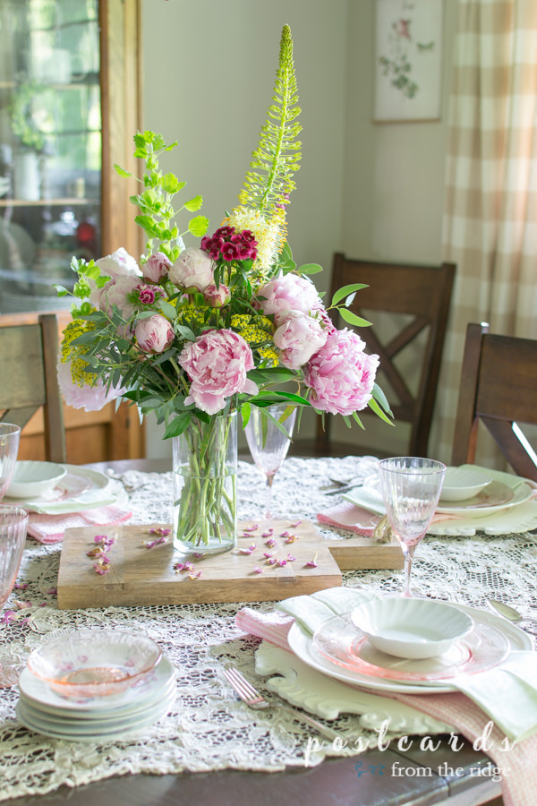 vintage dishes and pink peony centerpiece in spring tablescape