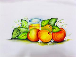 laranjas e copo de suco