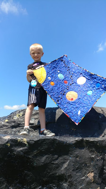 Solar system quilt made by a six year old