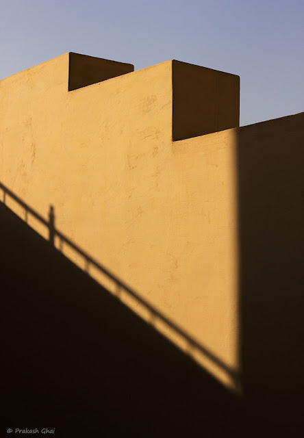 A Minimalist Photograph of the Edges of a Wall at Jantar Mantar, Jaipur with the Shadow of railing falling on it.