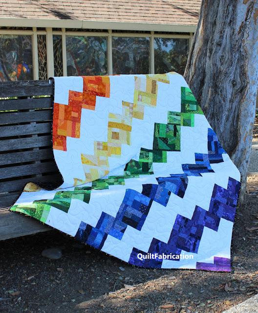 Rainbow Celilo scrap quilt on a park bench