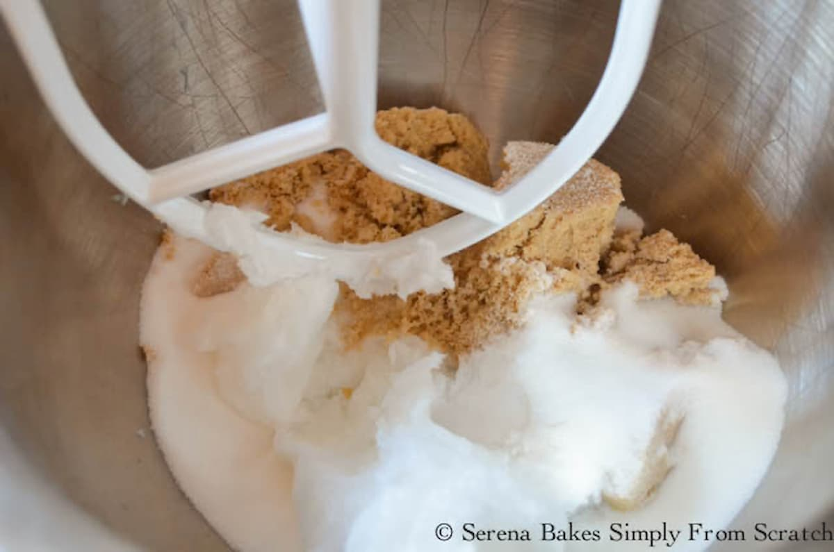 Brown Sugar, Granulated Sugar, and Coconut Oil in a stainless steel mixing bowl fitted with a mixing paddle.