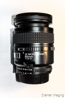 Cramer Imaging's stock photograph of a macro camera lens on a white background