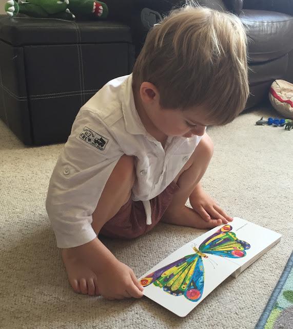 Bert reading The Very Hungry Caterpillar