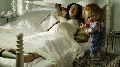 Child's Play: Seed of Chucky movie still where Jennifer Tilly is tied up by Chucky so she can give birth to his child