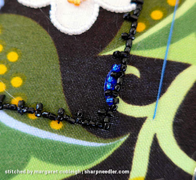 Royal blue beads added over the top of blue embroidery thread. Beads are too large so will be removed. (Wild Child Japanese Bead Embroidery by Mary Alice Sinton)
