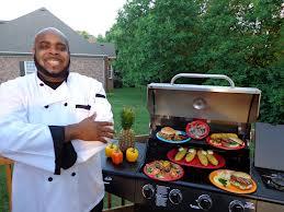 Chef Big Shake doing some serious grillin of His Shrimp Burgers