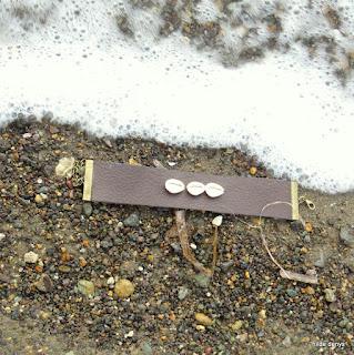 LoveLea's dark chocolate brown leather cuff with Kauri shells