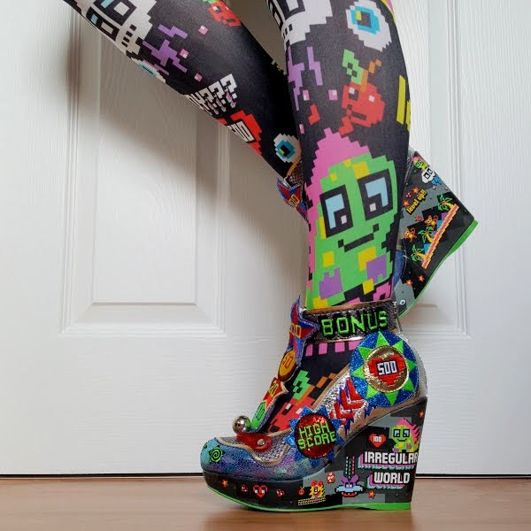 wearing patterned gaming tights with pinball themed wedge shoes