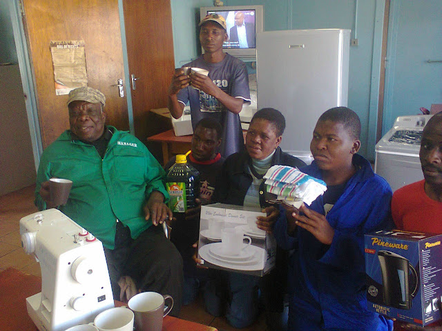 Umphumela Drop-In Centre staff with donations from Hollywoodbets Secunda