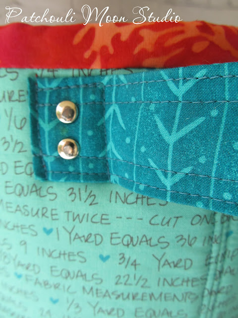 closeup look at handles with rivets on fabric container