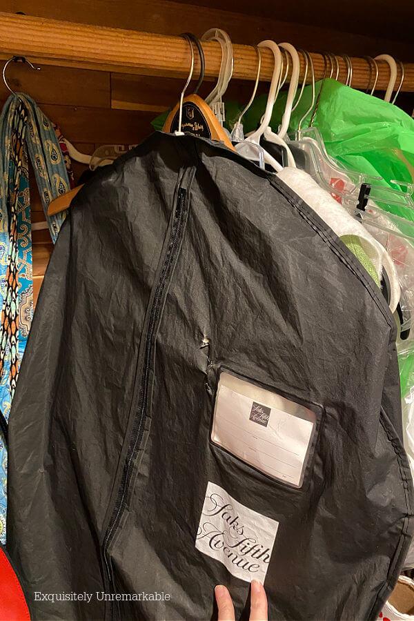 Garment bag hanging in closet