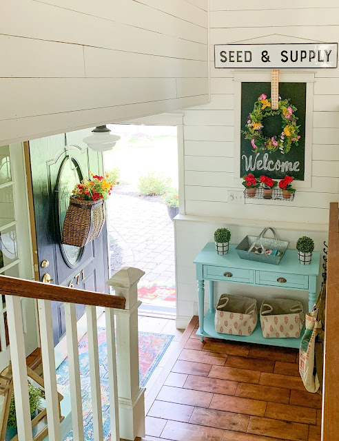 Foyer in home with colorful cottage farmhouse style decor - www.goldenboysandme.com