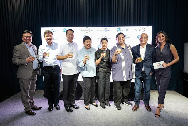 Lauren Reid with Ayala Malls and Globe Telecom Executives