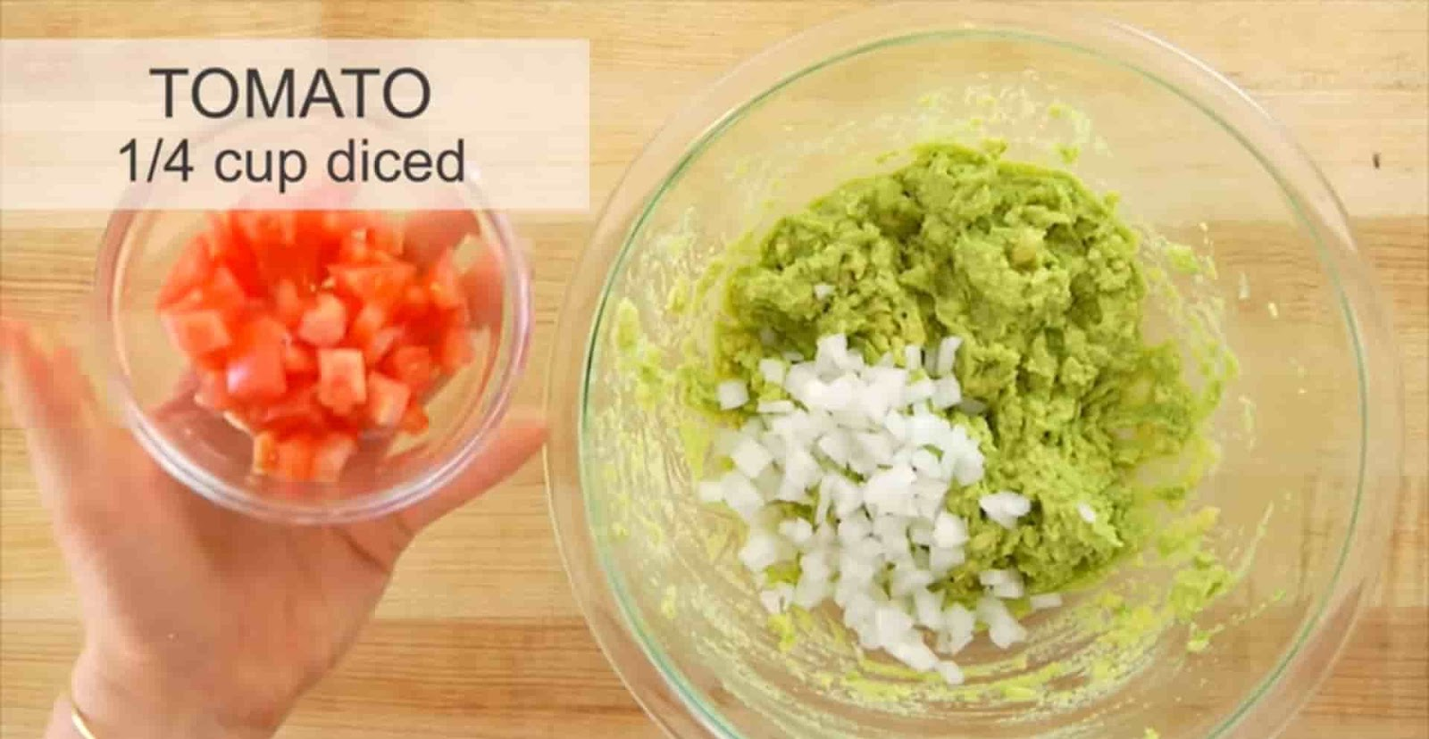Tomato-diced-putting-in-mashed-avocado