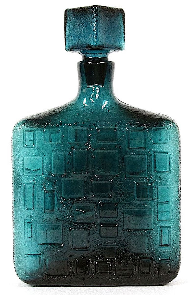 a teal glass decanter from Italy, detailed color photograph