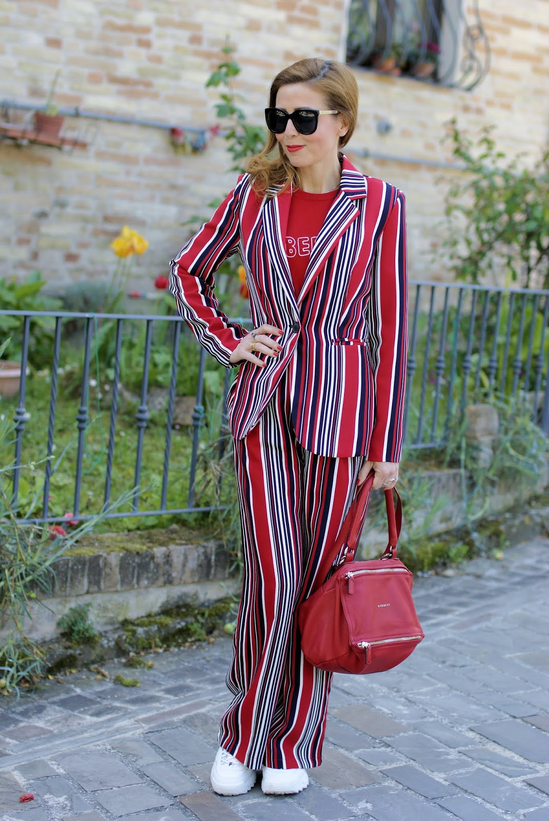 Suit up! A striped suit worn with sneakers on Fashion and Cookies fashion blog, fashion blogger style