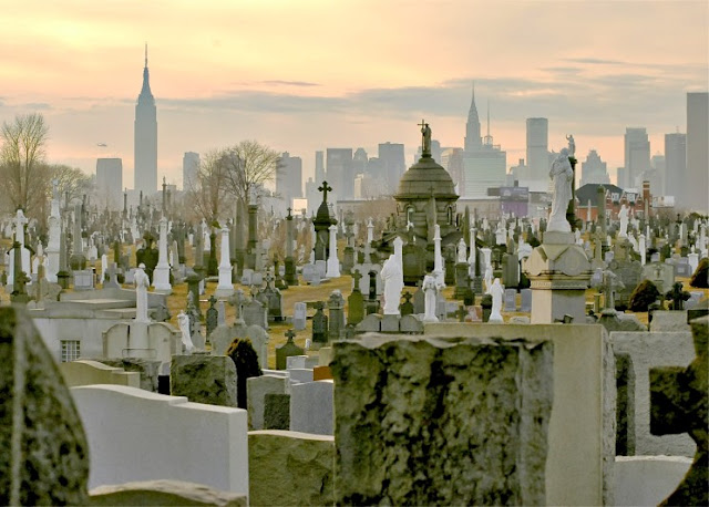 Very large cemetery isolated from the skyscrapers of New York city in the background