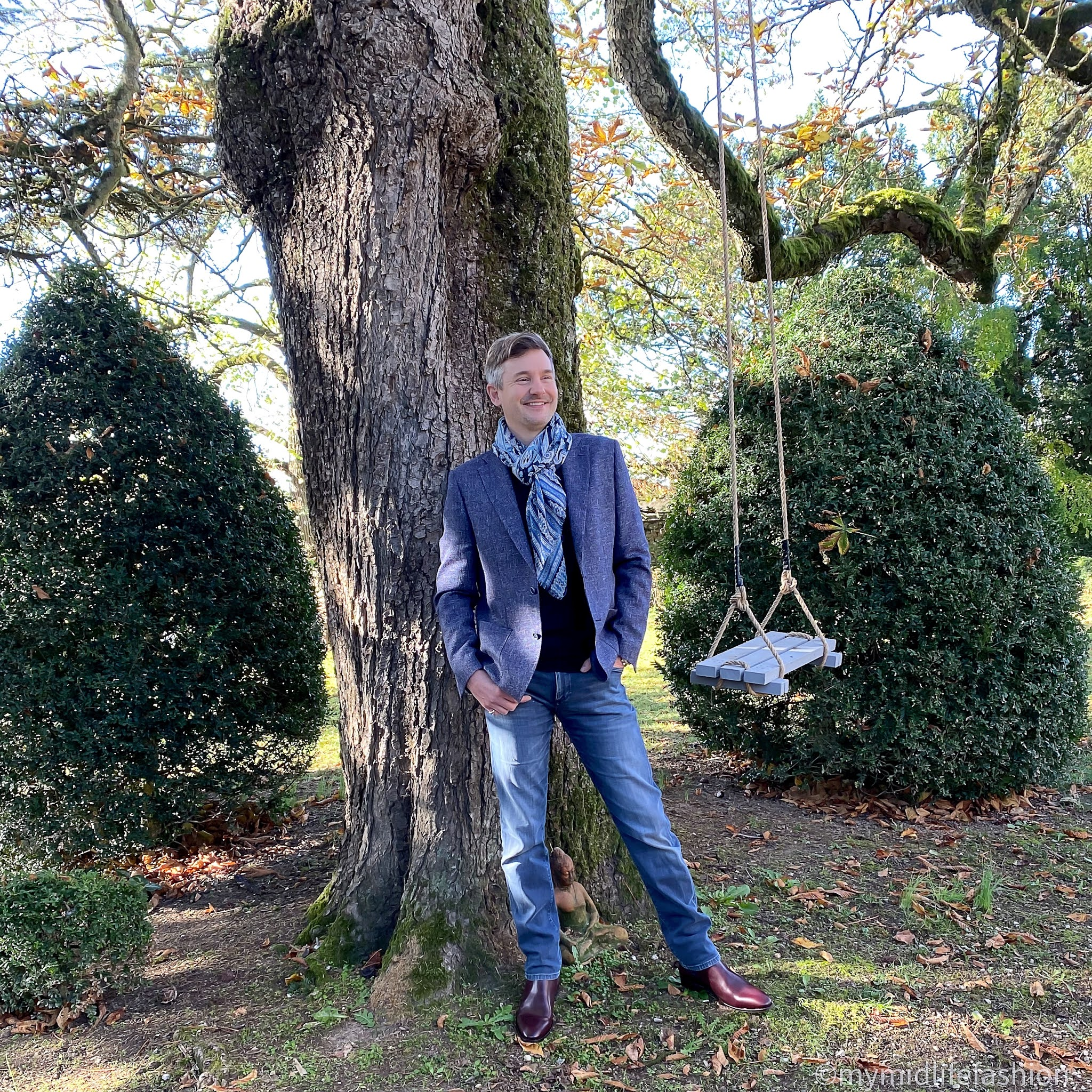 my midlife fashion, hawes and Curtis Italian wool linen blend mens jacket, hawes and Curtis merino wool polo neck jumper, hawes and Curtis navy and blue big paisley scarf, hawes and Curtis mens burgundy leather Chelsea boot