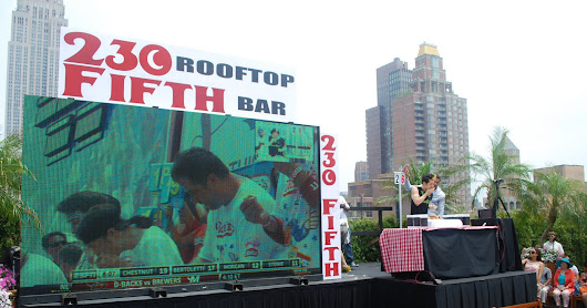 Kobayashi Downs Record 69 Hot Dogs To Win Simulcast Eating Competition