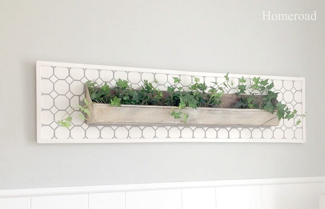 DIY tiled wall garden from a repurposed chicken feeder