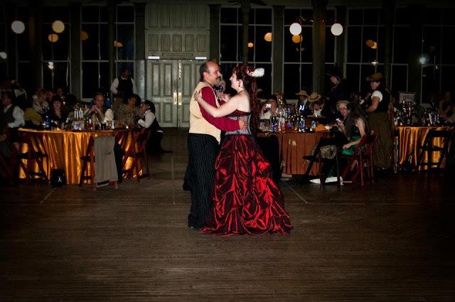 steampunk wedding, steampunk bride and groom, louise black corset, galveston, wedding, garten verein, steampunk wedding reception, red wedding dress, first dance