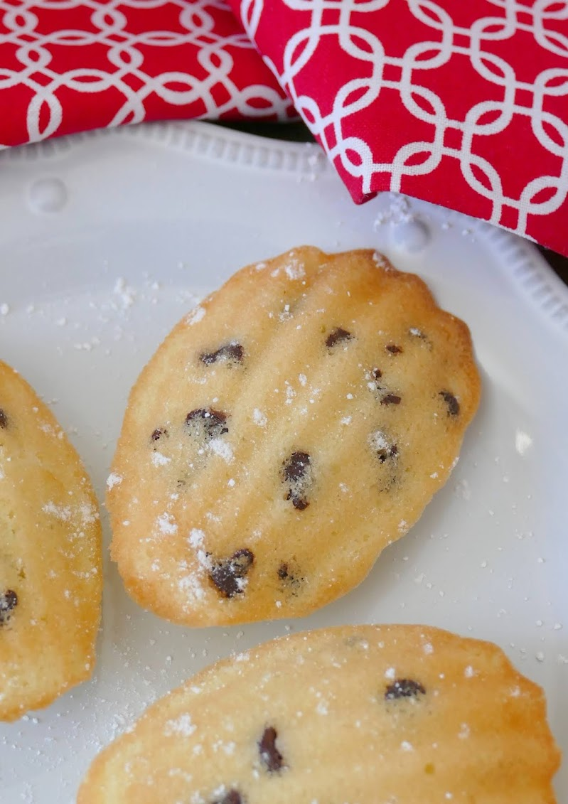 Mini Chocolate Chip Madeleines Recipe from Hot Eats and Cool Reads! These delicious little cake cookies are wonderful for any occasion! We love serving them at holiday parties, for snack or dessert! Also great with mint, butterscotch or white chocolate chips!