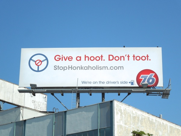 Give a hoot Don't toot 76 gas billboard