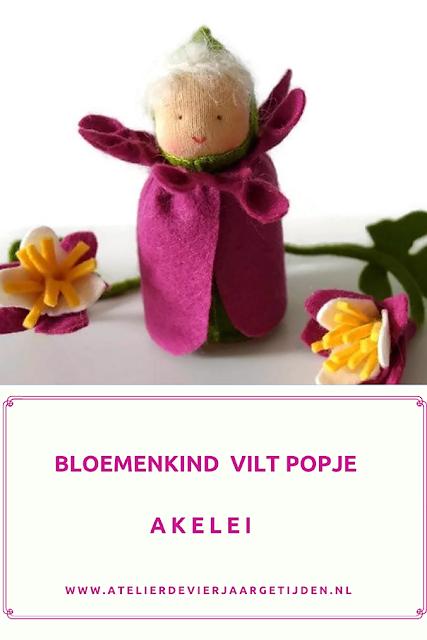 Vilten bloemenkind Akelei  met vilt bloem voor op de seizoentafel