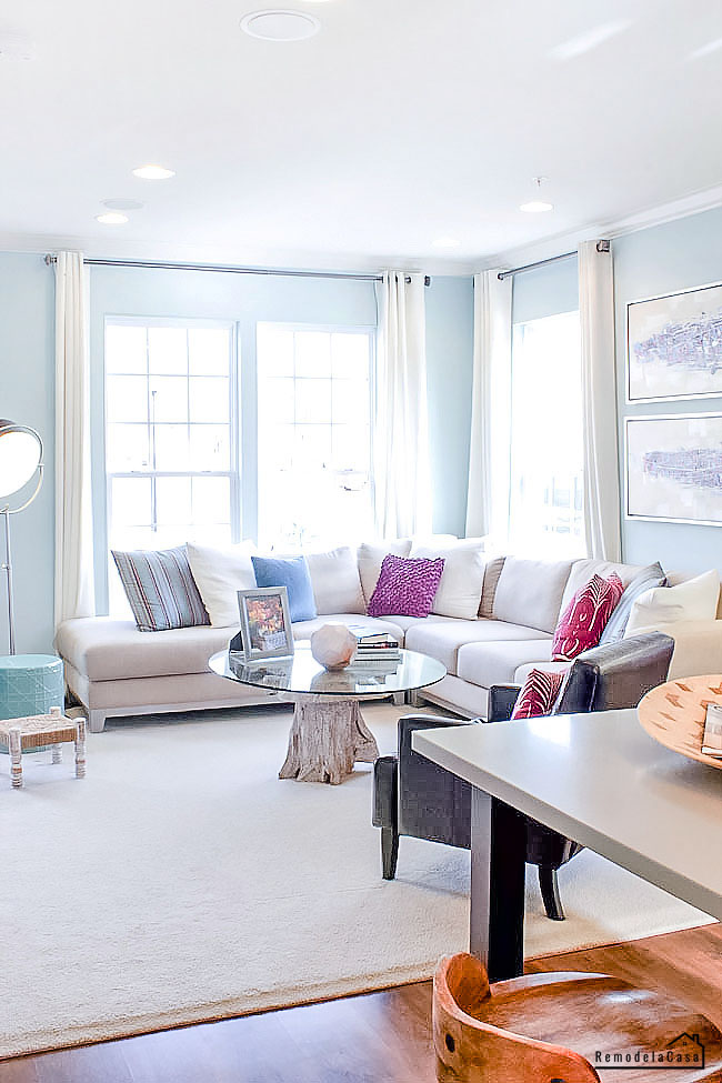 light blue and white family room with sectional - Miller and Smith builders