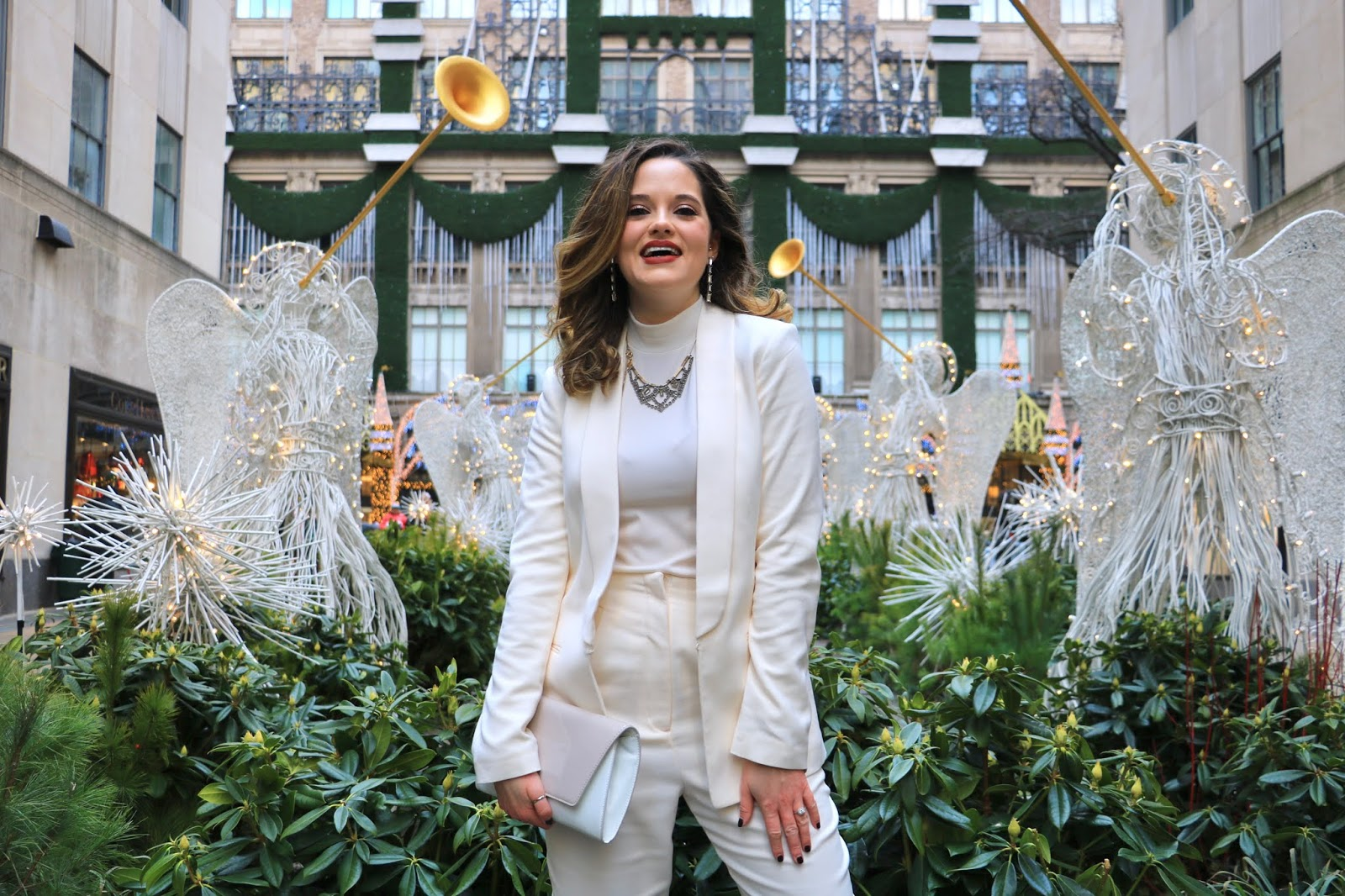 Nyc fashion blogger Kathleen Harper's photo shoot with the Rockefeller Center holiday decorations.