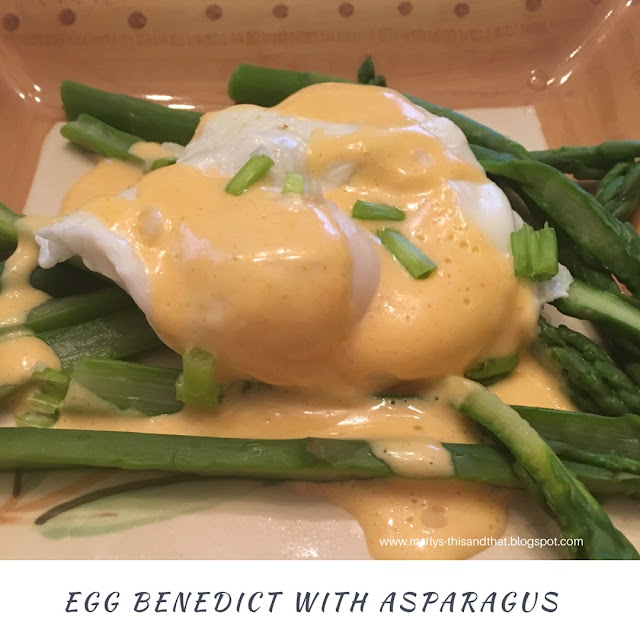 Egg Benedict and Asparagus together for a yummy breakfast.