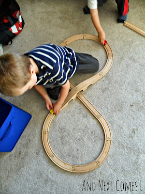 Tracing wooden train track numbers from And Next Comes L
