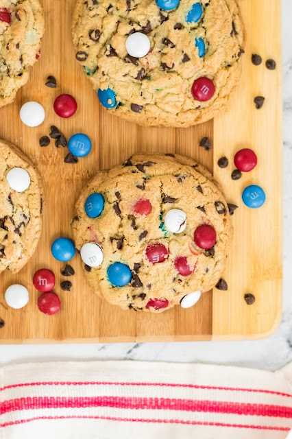cookie on a wooden board with red and white towel