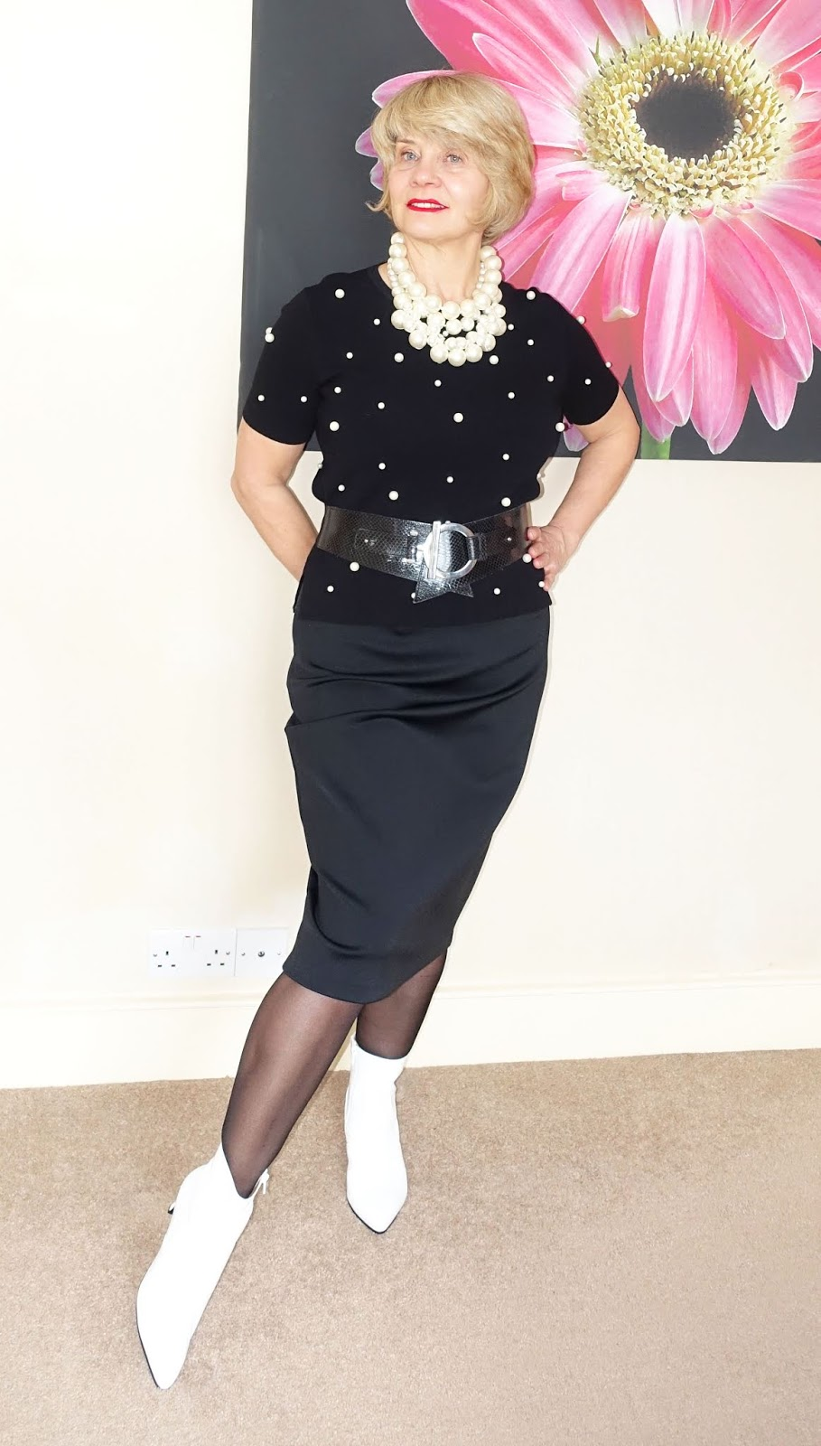 A black skirt and top with white ankle boots, layered pearl necklaces and 20 denier black shaping tights by FiOre, worn by over 45 blogger Gail Hanlon from Is This Mutton dot com