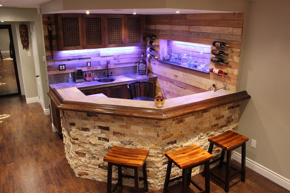 rustic bar with palette wood wall treatment