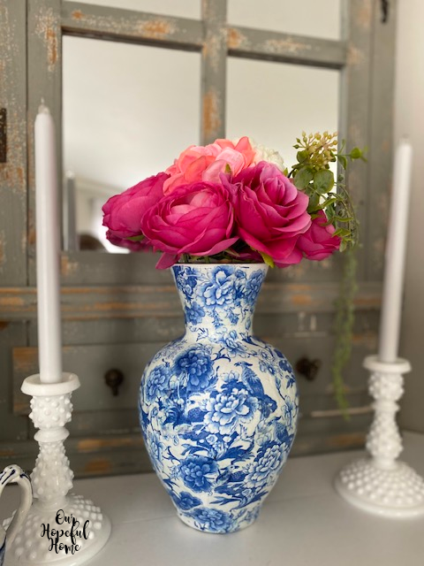 vase on white fireplace mantel
