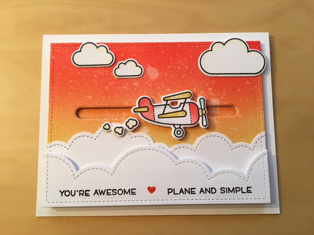 The finished slider card with Lawn Fawn Plane and simple