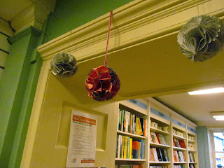 Baubles hanging in the doorways of the Old Hall Bookshop