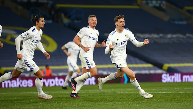 Leeds United player Diego Llorente celebrating goal against Liverpool
