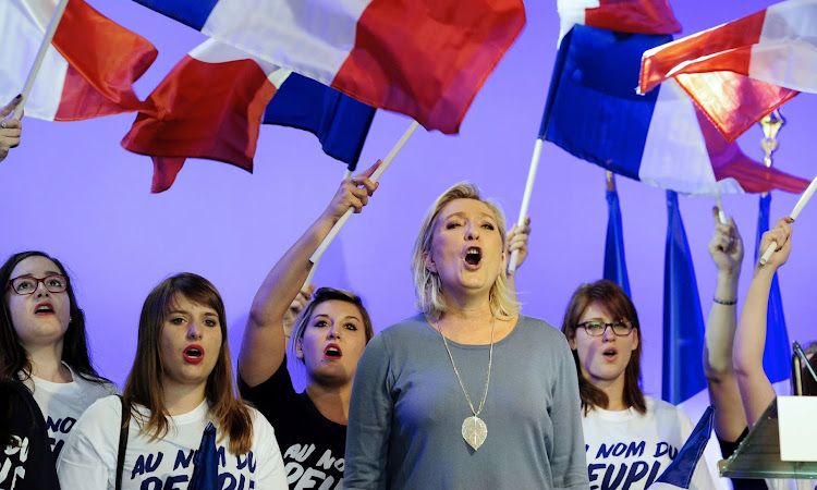 Marine Le Pen with French flag