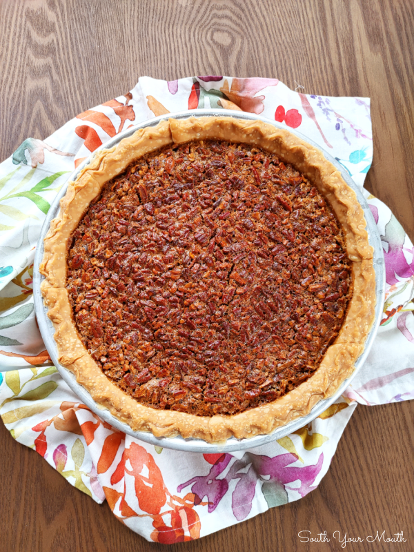 Classic Pecan Pie! A no-fail recipe for pecan pie with a smooth, caramelly filling studded with southern pecans perfect for Thanksgiving and Christmas dinner!
