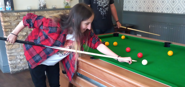 My eldest playing pool