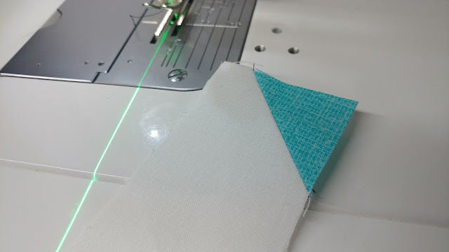 Using a sewing machine laser to sew stitch and flip corners